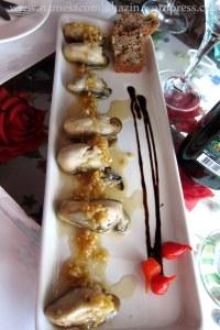 Ostras ao gengibre, cachaça e mel no Restaurante Ostradamus