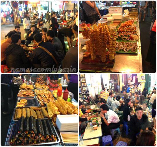 Ruas abarrotadas de pessoas e barracas de comidas em Hanói